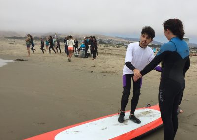 Project Surf Camp - Student on Surf Board