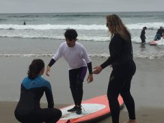 Project Surf Camp - Student Learning to Balance on Surf Board